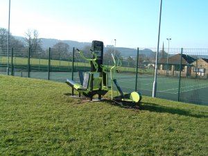 Photo of excersise equipment adjacent to the tennis courts